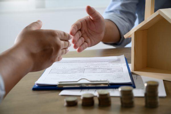 handshaking caucasian broker Real Estate and Agreement concept